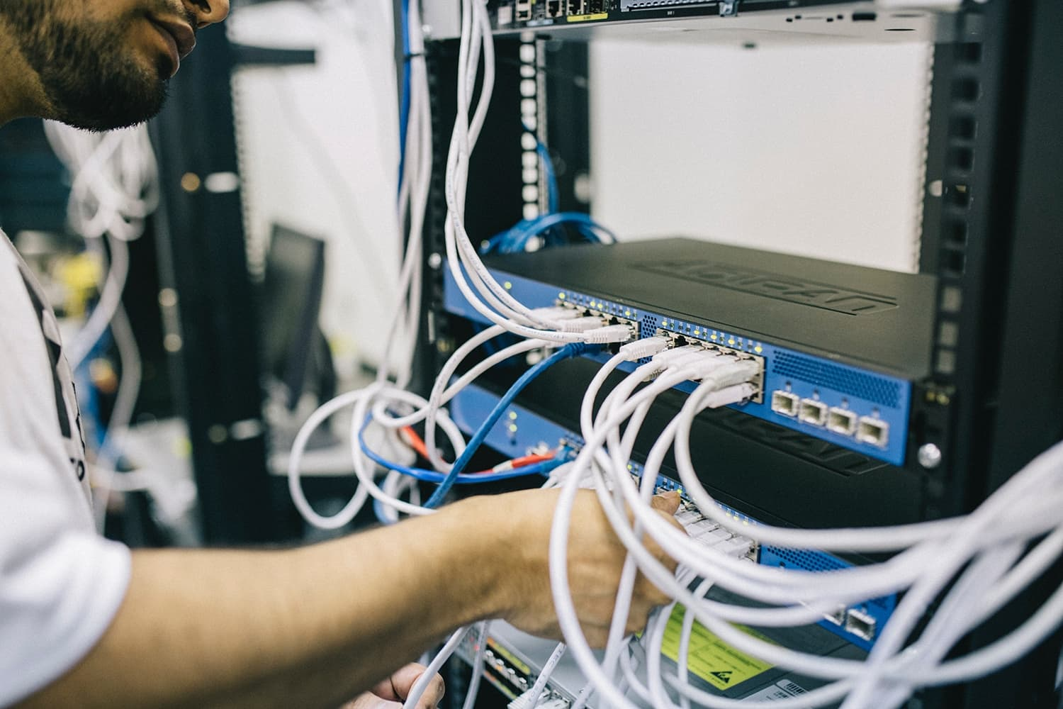 man connecting electronic cables