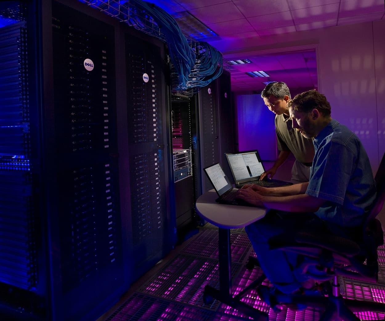 two men working in server room